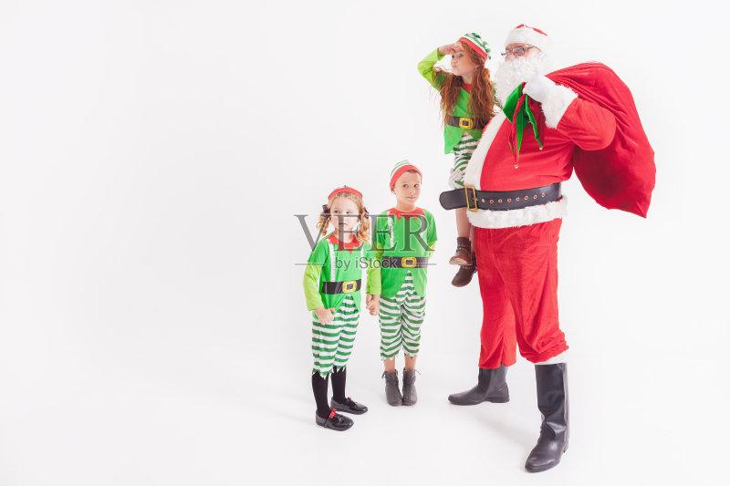 服饰-节日 女孩 许愿 白色 宗教圣徒 包 看 少女 红色 圣诞老人 白人 儿童图片